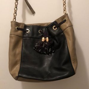 Neiman Marcus tana and black bucket bag